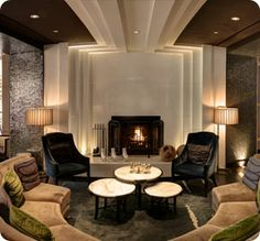 The lounge inside the Hotel Palomar in Philadelphia is stunning. Velvet chairs, a warm fireplace and cool architectural details make it a designer's dream. #visitphilly #phillyaphrochic