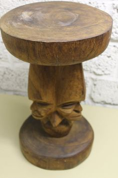 Pedestal Stools / Sculpture / Object dart Triple effigy figure  Wooden stool with a circular seat over a triple carved masks pedestal column.  Beautiful and decorative!  Strange, awesome Stool  It is an old stool, probably made in the 70s or earlier  aprox. 40 cm tall (15.75 inches) Diameter: 24 cm (9.45 inches)  Material: wood  Weight: 3,8 kg (8.37 pounds)  Very good vintage condition, with traces of age, patina  Shipping:  Deutschland: 5,99 €  Shipping:  European Union 17,00 €  Sc...
