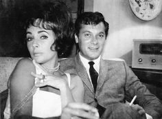 Elizabeth Taylor and Tony Curtis attend a party at the Holmby Hills residence of Gary Cooper in 1960