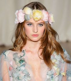 From the vibrant pink, yellow, and purple buds, the flower crown hair trend is totally having a moment.