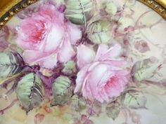Offered for sale is this absolutely beautiful, Limoges plate featuring a romantic, Victorian bouquet filled with prom pink, sweetheart roses