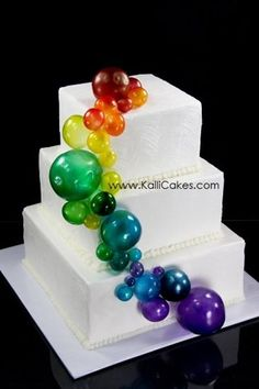 """Spring Showers bring Rainbow Bubbles!"" -- ""Gelatin Bubbles airbrushed with color adorn this 6"", 8"" and 10"" tiered cake."""