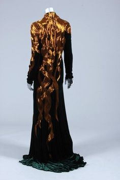 Alexander McQueen bottle green velvet and bugle beaded evening gown, 'In memory of Elizabeth Howe, Salem 1692' collection, Autumn-Winter, 2007, labelled and size 46, the amber-gold beading applied in tress-like bands down the front and back of the gown, trained skirt
