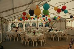 Bright Paper Lantern Wedding!                         Our wedding marquee: multi coloured paper lanterns Hung on covered Hula Hoops(attached battery powered lights inside) :-)