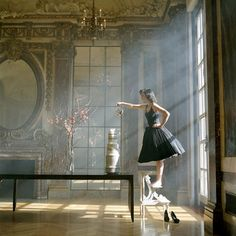 I love her poise, her dress and that placement of her chair in front of the window.   beautiful.  Photographer: Rodney Smith