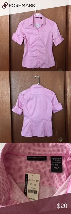 NWT. New York & Company button down Pink and white squares button up blouse, it has never been worn. New York & Company Tops Button Down Shirts