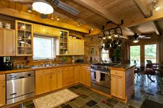Kitchen of Log Home on 10.5 acres with panoramic vistas, 1 acre pond and 2 story art studio/workshop/garage for sale in the mountains of West Virginia. realplanz.com/ #loghome