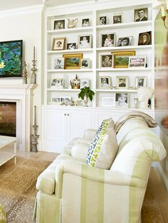 Turn bookshelves into a family photo zone by lining them with framed photographs. Place small photos on stacks of books if there's room for both. If your shelves are deep, try pushing the books to the back and placing photos in front.