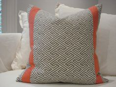 "Coral me Wild - 23"" x 23"" grey geometric print pillow with coral linen detail bands."