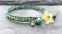 Green and gold leather and bead bracelet with glittery star button and bell £10.00