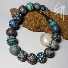 Another great color combination of blues & browns. The necklace by E.H.design, via Flickr