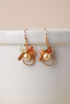 Anne Vaughan Designs - Harmony Gemstone Cluster Earring, $40.00 (http://www.annevaughandesigns.com/harmony-gemstone-unique-designer-dangle-chalcedony-earrings-for-women/)
