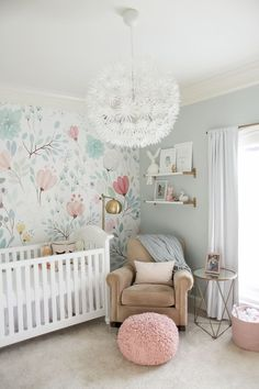 This Is The Prettiest Little Girls Nursery With The Most Amazing Floral Feature Wall The Light Fixture Is Beautiful And So Is The Little Pink Stool Pouf