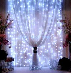 DIY Strings of mini-lights attached to a rod behind sheer fabric. Beautiful!