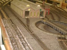 engine shed and turntable extended view including water tower and running lines, aspire gifts and models shop model railway layout, model trains, model railways