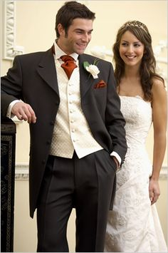 Mens Formal Hire   Wedding shop in Cheltenham.  I like the red tie, white vest, and dark tux.