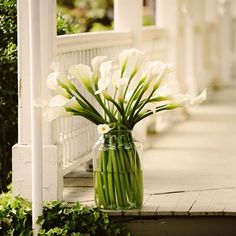 Simple but beautiful white calla arrangement for wedding day decor.