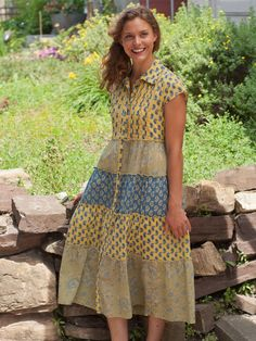 I love this fun mix of blues, yellows and sages bursting from the Indian-themed block prints and loosely drawn flowers. Because we design all our prints and fabrics by hand we are thrilled to create such unique, beautiful garments. The natural waisted bodice also has eight inset rows of our heirloom quality crochet lace.
