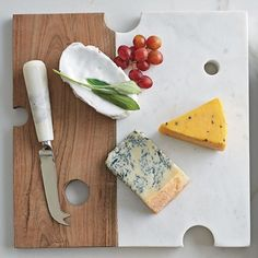 Marble Cheese Board with Knife - Carved into the shape of Swiss cheese, this modern white marble and acacia wood cutting board is an elegant way to display crackers and assorted cheese. Marble Cutting Board, Wood Cutting Boards, Marble Cheese Board, Cheese Boards, Granite, Cheese Pairings, The Company Store, Serving Board, Charcuterie Board
