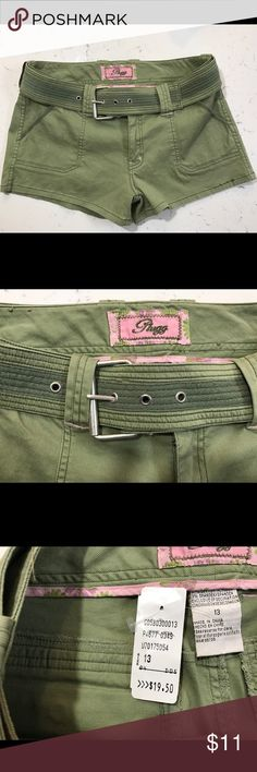 """Plugg belted shorts Juniors 13 Plugg green belted shorts with 2 front pockets and 2 back pockets with flap closure Belt is two toned green and is 2"""" wide 9"""" rise 3"""" inseam 10.5"""" long at side 16.5"""" waist side to side  New unworn  (my item Plugg Shorts Jean Shorts"""