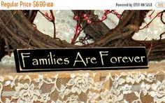This item ships in 2 weeks with your choice of colors. See drop down boxes above for color choices.  Verse: Families Are Forever - Shelf Sitter  Size: 2 X 12  Colors Pictured: Black Background with Cream Lettering.  Finish Pictured: Sanded edges create a worn look.  Our Shelf Sitters are meant to accent any small space in your home. Works great on Book Shelves, End Tables or any little area that needs something special. Shelf Sitters DO NOT come with Saw tooth hangers. A hole for hanging is…