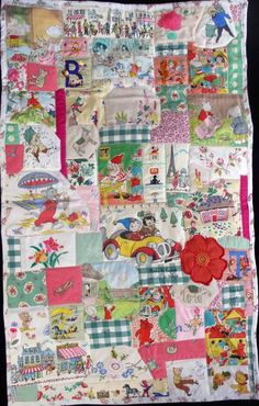 Crazy patchwork quilt made with vintage children's fabrics with a pink and green theme.