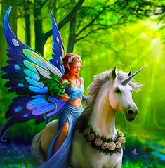 Fairy riding a unicorn with a dragon on her arm, I dare you to find a more fantasy picture
