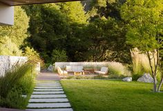 the rectangle/ square block walkway on this scale is also a modernist cliche, The grass as barrier as well but Monterey landscape designer Bernard Trainor goes beyond modernist in other plant mixes. His photos show some good transitions from dry garden to borrowed landscape