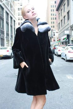7a1f97181f Marc Kaufman Furs presents a black sheared mink fur stroller with  chinchilla wing collar from Marc