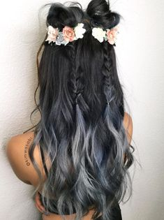 Charcoal hair is here and having a serious moment. Adding floral details to the hairstyle makes it look super girly. Two messy buns, two small braids, and the most beautiful hairstyle is ready to rock the party.