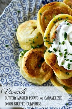 Vareniki {buttery mashed potato and caramelized onion stuffed pierogie style dumplings} with sour cream and chives.