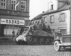 Willys MB Jeep and a M4A1 (76mm) W in Dobrany Czechoslovakia, 6 May 1945. Probably of 8th Armored Division. The Jeep is from 38th Infantry, 2nd 'Indianhead' Diovision.