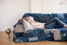 Awesome sofa cover - search flea market for jeans, sew together and throw over an old but comfortable sofa.