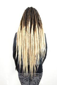 This is bella, she wanted a change in her short dreadlocks that were half about this length. The ends of her dreadlocks were blond so I extended her dreads with human hair in blond to match this.  Here is her long long dreadlocks. Now she can play with different hairdos. =)