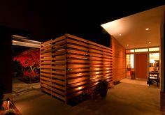 Love this fence and outdoor lighting scheme.