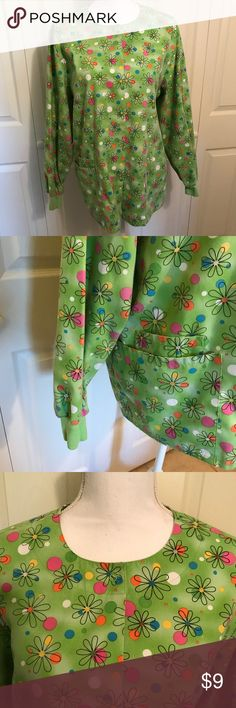 """HQ • green flowered scrub top Long sleeve scrub coat with button closure in front. Cuffed sleeves and two pockets on front. Some fading from wash and minor pilling on cuffs. Bust 22. Length 27"""". Size medium  Green with flowers and polka dots in pink organs blue and yellow HQ Other"""