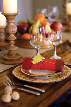 Thanksgiving: use sprigs of herbs, fall leaves, or branches as part of your napkin rings. Tie it with twine.