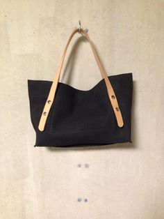 KP#1356 small leather tote in black; magnetic lock and tanned adjustable handles