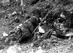 A soldier of the Troops of the Entente lying dead after losing his life in the area of Monte Cucco during the Tenth Battle of the Isonzo...