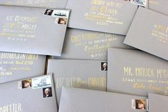 Hand-addressed envelopes in gold and white guache