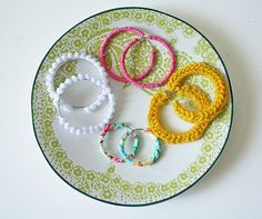 tutorials for using fabric & yarn to make four different styles of hoop earrings, i must try this!