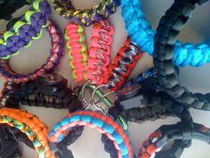 An assortment of paracord bracelets and key chains, by Paracordable.