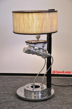 ***NOTE: ORDERS PLACED AFTER NOVEMBER 24TH WILL NOT HAVE A GUARANTEED CHRISTMAS DELIVERY*** This lamp design was my 2nd-ever creation, first fabricated in 2010. Parts used: Brake master cylinder, cross-drilled brake rotor, stainless steel braided brake hoses, laser-cut & TIG welded steel plates (post), and an automotive air filter for the shade. You will not find a cooler lamp for a gear head / car enthusiast! Great conversation starter for the mancave. I MIG and TIG weld some of ...