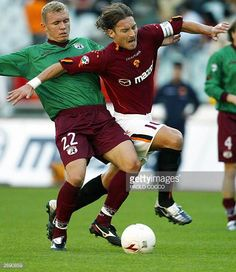 Roma's captain Francesco Totti challenges Reggina's midfielder Santos Mozart of Brazil during their Serie A soccer match at Rome's Olympic stadium 02...