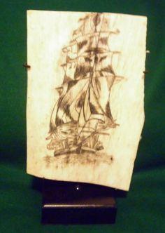 "Pan bone scrimshaw showing a ship in full sail. 12"" X 8 """