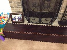Wood Grain play mat for baby proofing your fireplace! We bought it and it works great for it! Plus it looks nice! Follow me on Pinterest. @Samnaylor http://www.amazon.com/gp/aw/d/B002YQWKHE/ref=redir_mdp_mobile?ref_=cm_cmu_pg__header