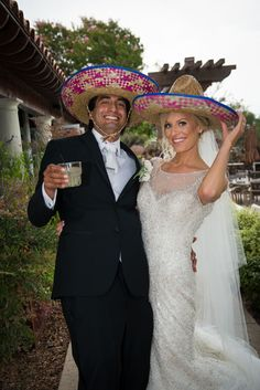 The outdoor cocktail hour was decorated with Mexican colors and props to honor the groom's heritage. You can't help but smile while wearing matching sombreros! Fun Wedding in the Santa Cruz Mountains | Chaminade Resort and Spa | Neil Simmons Photography