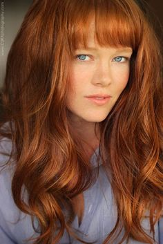 Pretty redhead with blue eyes.