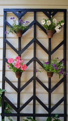 build a tall chevron lattice to hold flower pots - Easter Avenue Co on @Remodelaholic