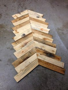 How to Build an Inexpensive Chevron Coffee Table - Great explanation given on how he did it.